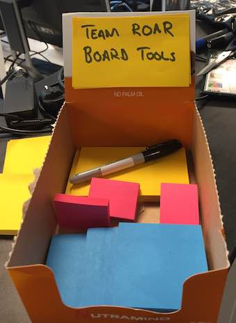 Box with tools, and only the 'correct' coloured stickies